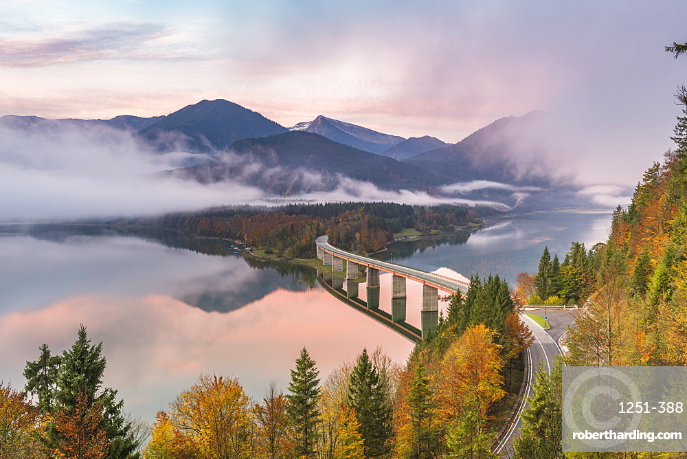 Sylvenstein Lake and bridge surrounded by the morning mist at dawn, Bad Tolz-Wolfratshausen district, Bavaria, Germany, Europe