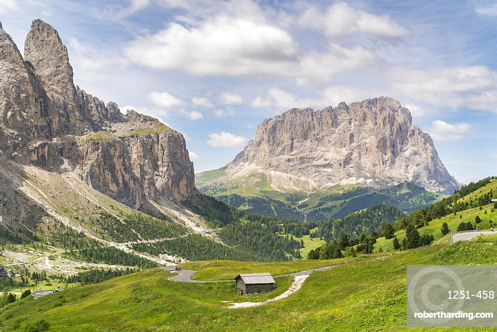 Sella group on the left and Langkofel on the right, shot from Gardena Pass in summer. Bolzano province, Trentino Alto Adige, Italy.