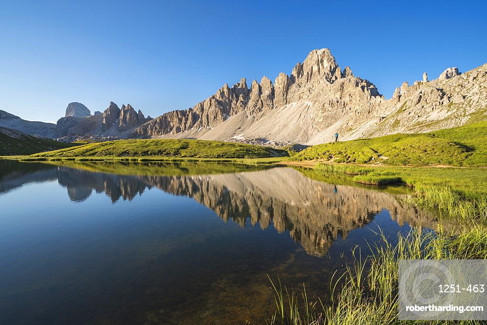 Reflection of Mount Paterno, Croda dei Piani and Croda di Toni on Piani Lakes in summer. Sesto Dolomites, Trentino Alto Adige, Italy.