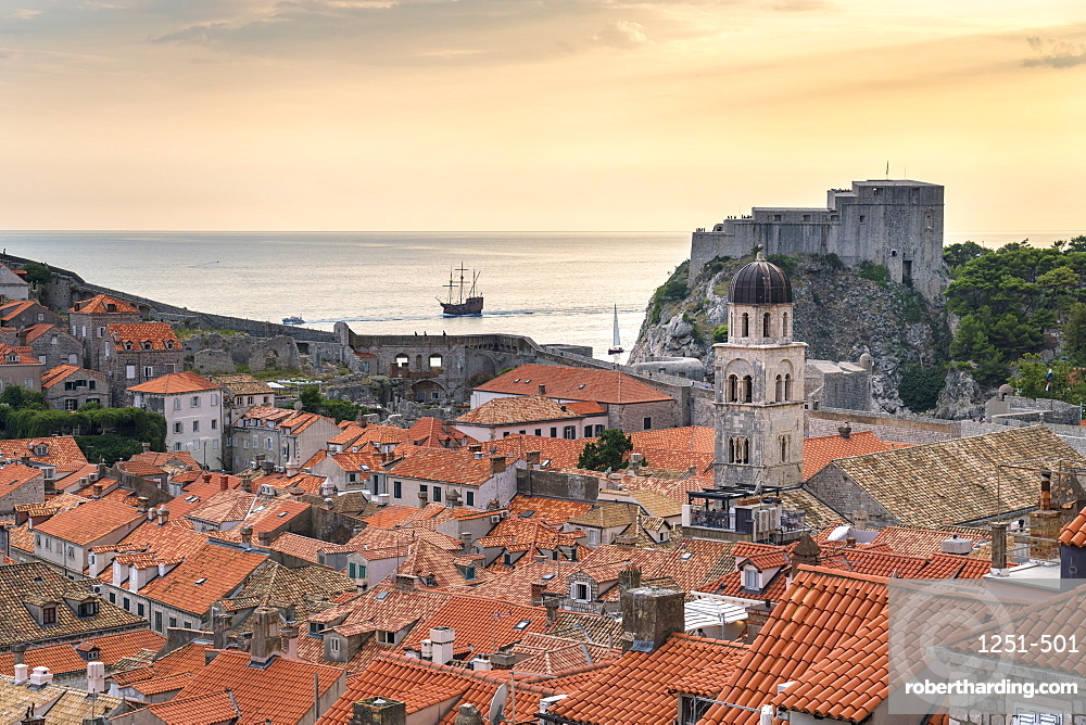 View of the old town at sunset, with Franciscan Monastery and Fort Lovrijenac. Dubrovnik, Dubrovnik - Neretva county, Croatia.