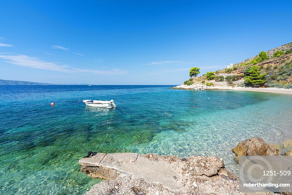 Boat and beach in summer. Murvica, Bol, Brac island, Split - Dalmatia county, Croatia.