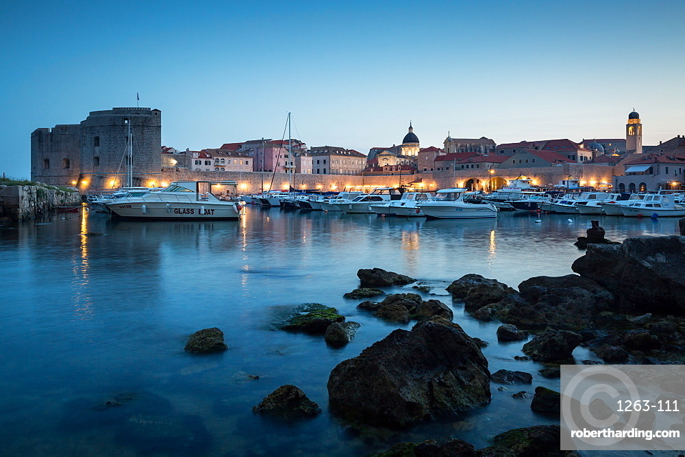 The lights of old town Dubrovnik and its harbour during blue hour, Dubrovnik, Croatia, Europe