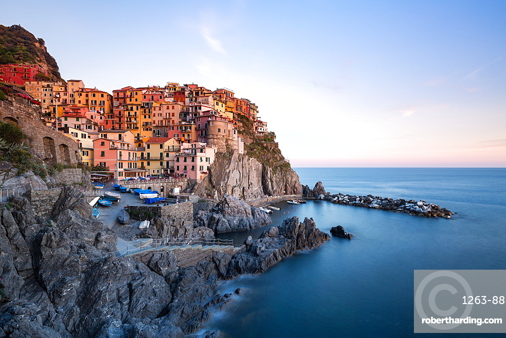 Beautiful sunset light shines on the colourful town of Manarola during a long exposure, Manarola, Cinque Terre, UNESCO World Heritage Site, Liguria, Italy, Europe