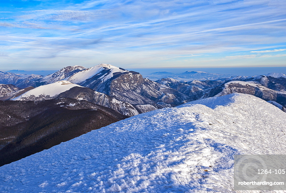 Italy, Umbria, Apennines, Sunrise on Mountain Catria from the summit of Cucco in Winter