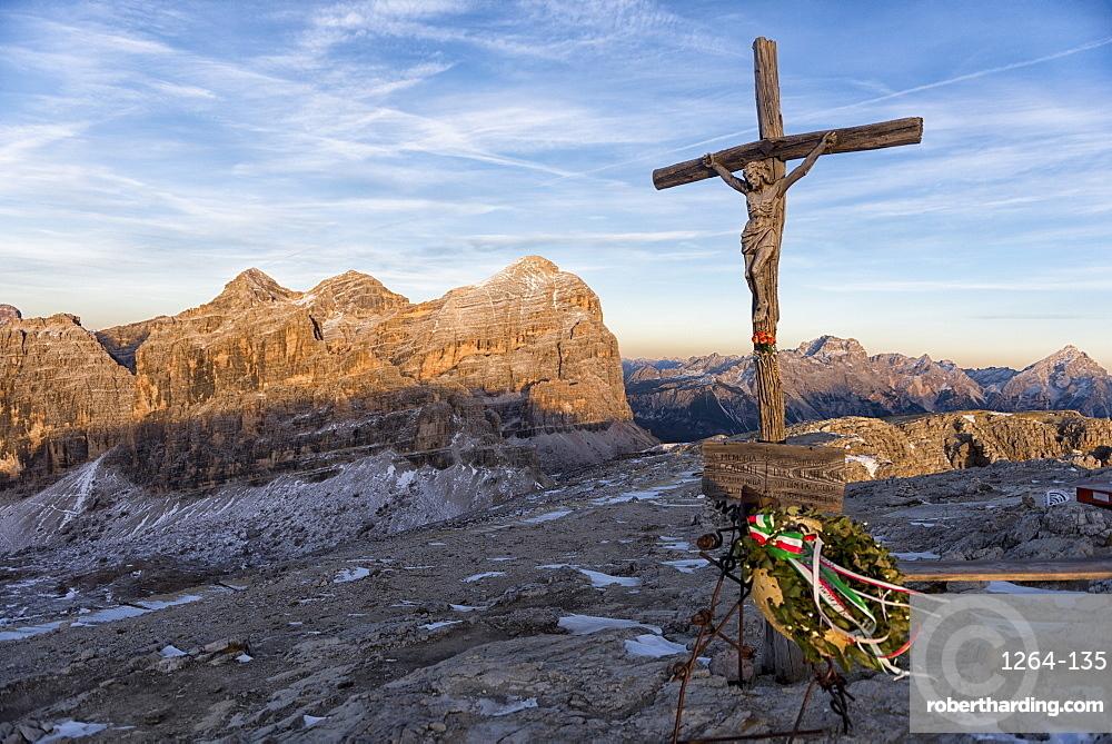 Italy, Veneto, Dolomites, Summit Cross of Lagazuoi at sunset