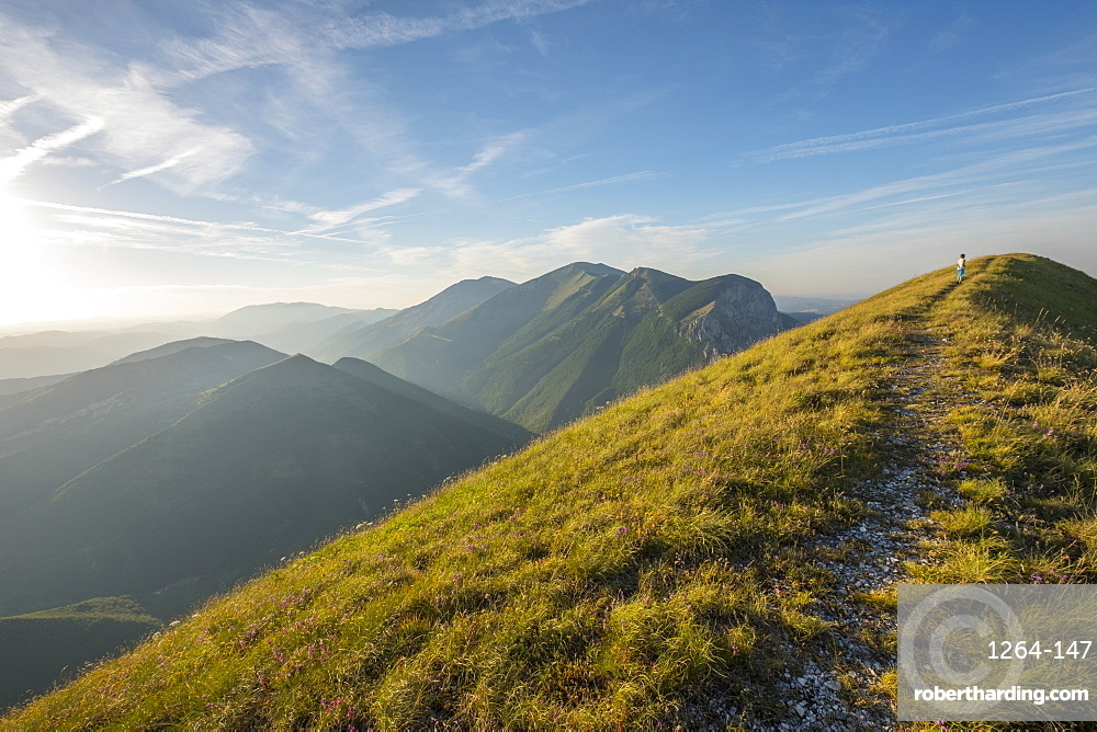Young hiker on the summit of Mont Motette, Apennines, Umbria, Italy, Europe