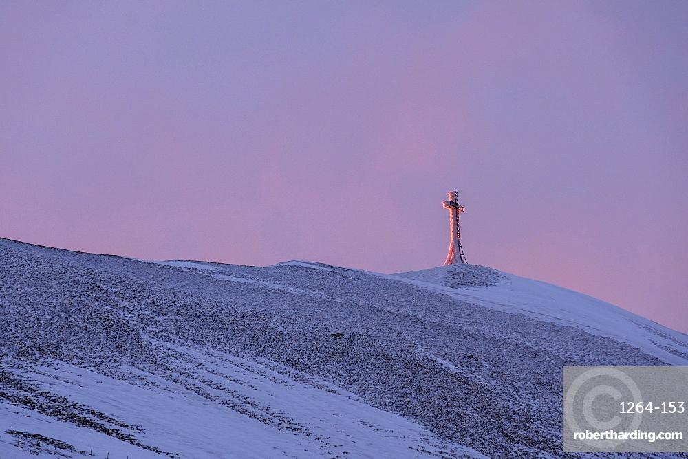 Summit cross of Monte Catria at sunrise in winter, Apennines, Umbria, Italy, Europe