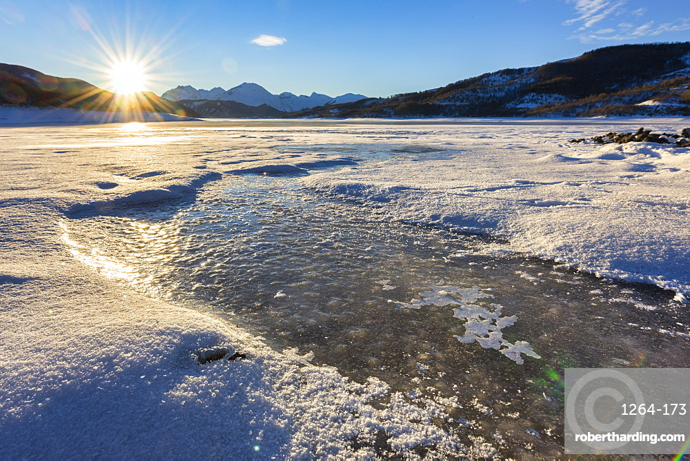 Lake Campotosto at sunrise in winter, Gran Sasso National Park, Abruzzo, Italy, Europe