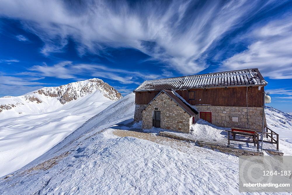 Corno Grande peak and Duca degli Abruzzi mountain hut in winter, Gran Sasso e Monti della Laga, Abruzzo, Apennines, Italy, Europe
