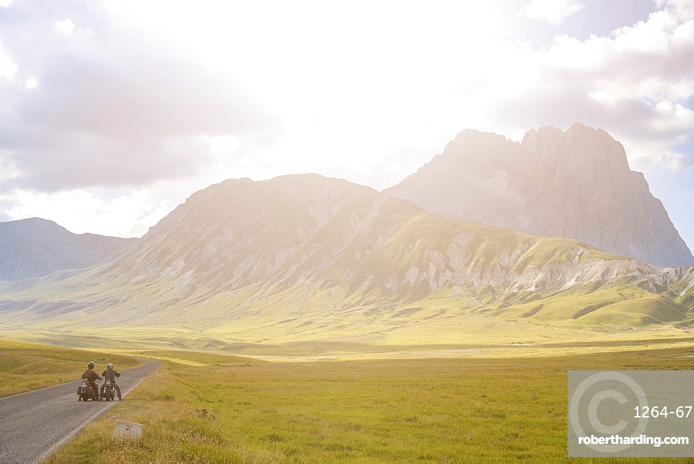 Bikers in plateau Campo Imperatore at sunset, Gran Sasso e Monti della Laga National Park, Abruzzo, Italy, Europe