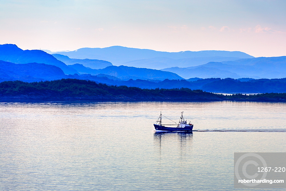 Tranquil coastal scenery at dawn south of Bergen, Hordaland, Norway.