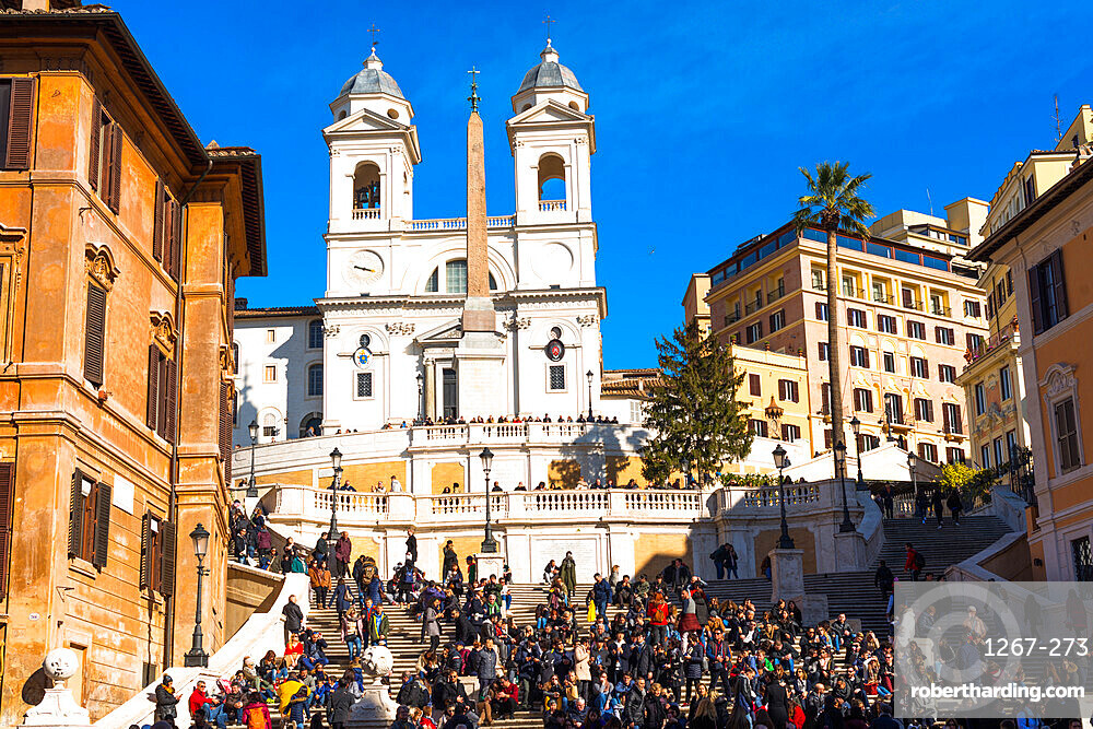Piazza di Spagna with crowed Spanish Steps and church of Santissima Trinita dei Monti to the rear, Rome, Lazio, Italy, Europe