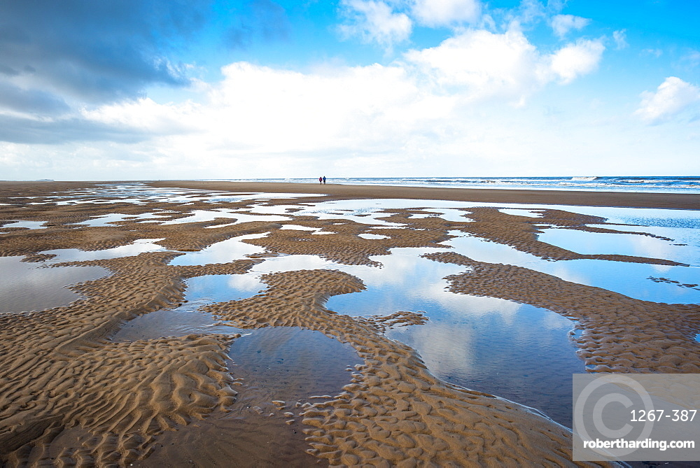 Pools of water making patterns on the beach at Holkham Bay, North Norfolk coast, Norfolk, East Anglia, England, United Kingdom, Europe