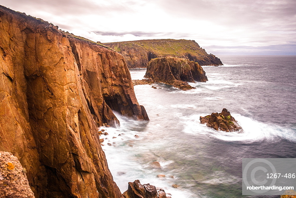 Coastal scenery with Enys Dodnan rock formation at Lands End, Cornwall, England, United Kingdom, Europe.