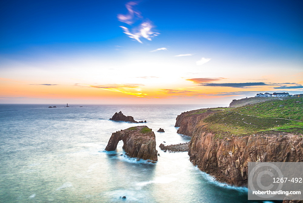 Dramatic sky at sunset with Enys Dodnan and the Armed Knight rock formations at Lands End, Cornwall, England, United Kingdom.