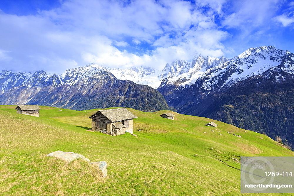 Traditional huts with Pizzo Badile in the background, Soglio, Val Bregaglia (Bregaglia Valley), Graubunden, Switzerland, Europe