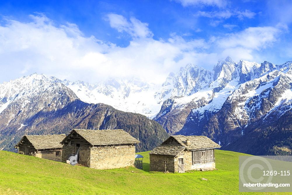 Traditional huts with Masino-Bregaglia group in the background, Soglio, Val Bregaglia, Graubunden, Switzerland, Europe