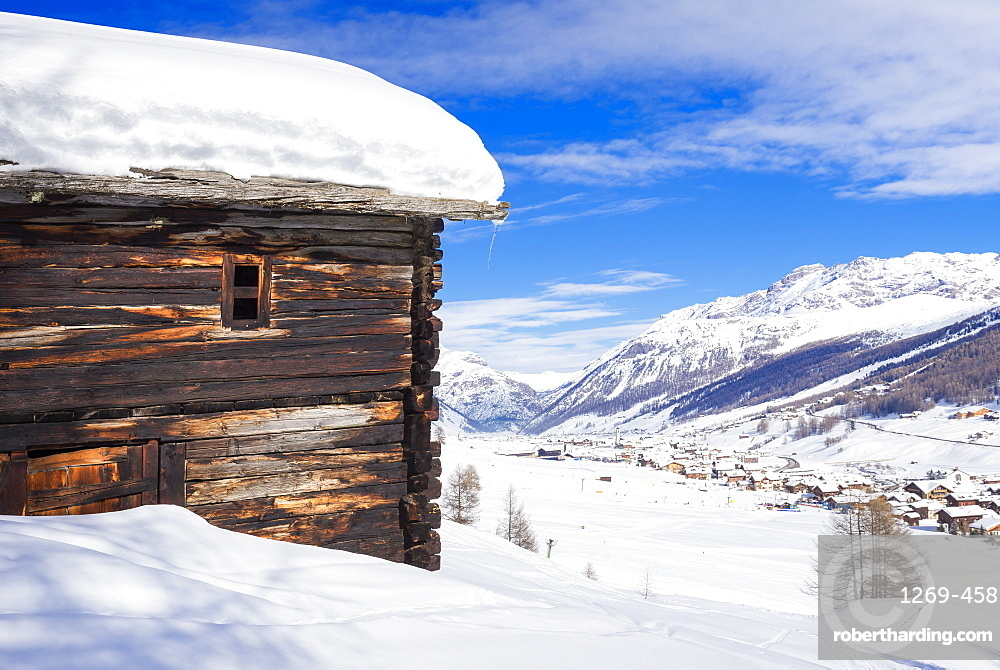 Tradiitional hut with view on the village, Livigno, Valtellina, Lombardy, Italy, Europe
