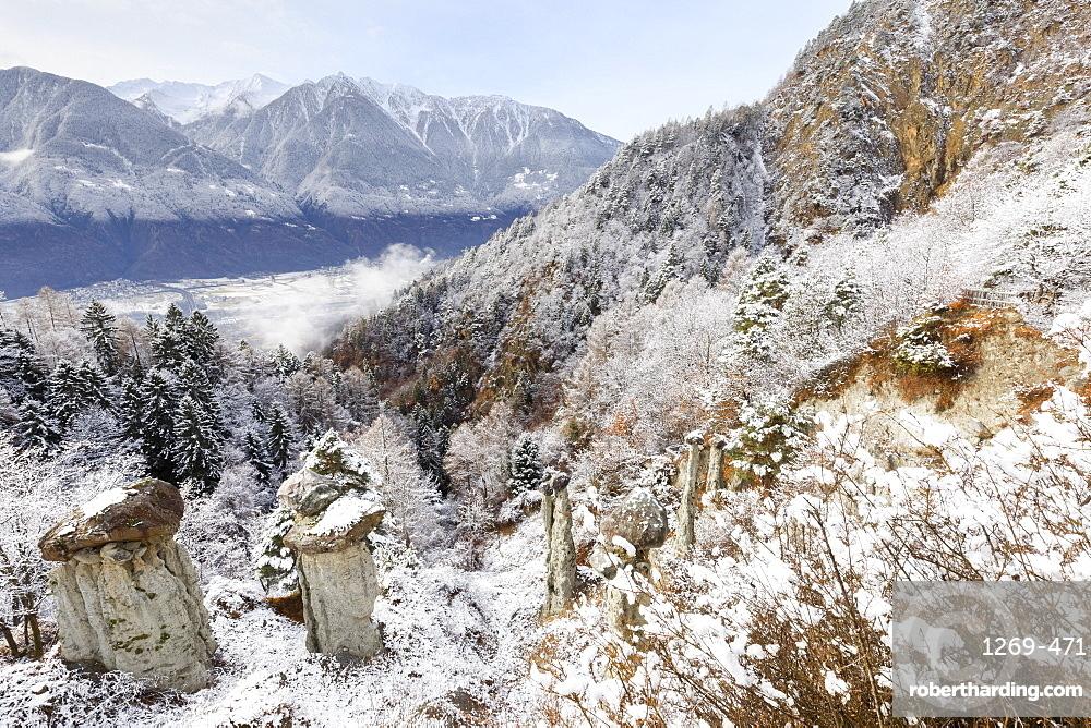 Hoodoos of Postalesio after a snowfall, Postalesio, Valtellina, Lombardy, Italy, Europe