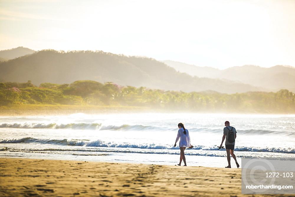 Couple on Playa Buena Vista Beach at sunrise, Guanacaste Province, Costa Rica