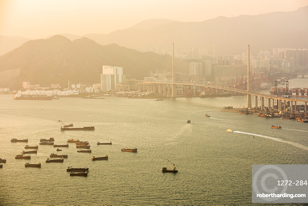 Boats in Victoria Harbour at sunset, seen from Victoria Peak, Hong Kong Island, Hong Kong, China, Asia