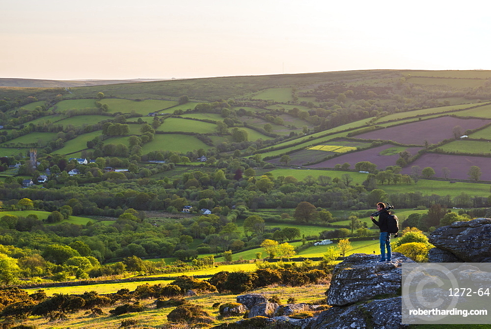 Photographer on a Tor in Dartmoor National Park, Devon, England, United Kingdom, Europe