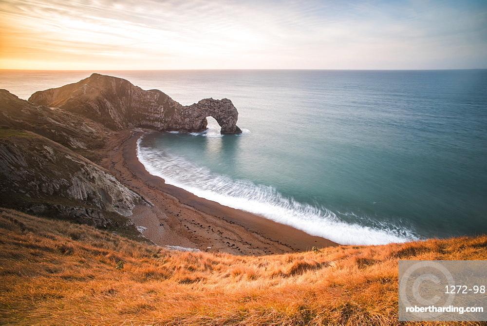 Durdle Door at sunrise, Lulworth Cove, Jurassic Coast, Dorset, England