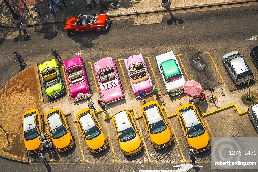 Aerial view colourful old American taxi cars parked in Havana, La Habana, Cuba, West Indies, Caribbean