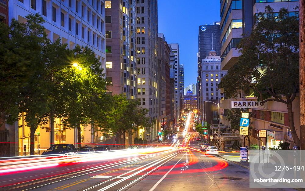 Car trail lights on Bush Street, Oakland Bay Bridge in the background, San Francisco, California, United States of America, North America