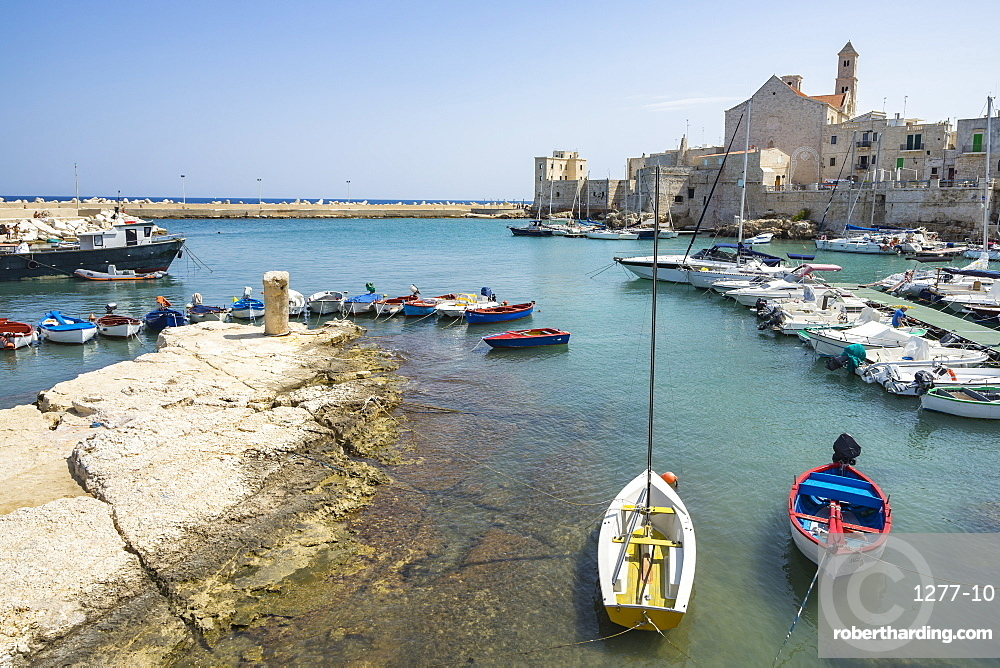 Colorful boats moored at Giovinazzo harbour, Apulia, Italy