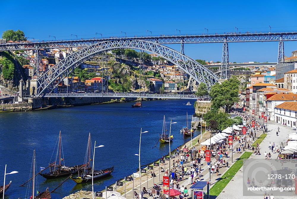 View of Dom Luis I Bridge over Douro River and Vila Nova de Gaia waterfront with Porto wine ships and Ribeira view, Porto, Portugal, Europe