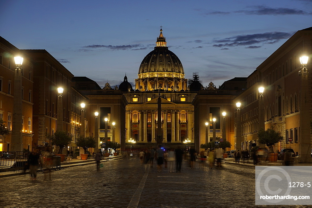 St. Peter's Cathedral night view with passing crowd, from Via della Conciliazione, Rome, Lazio, Italy, Europe