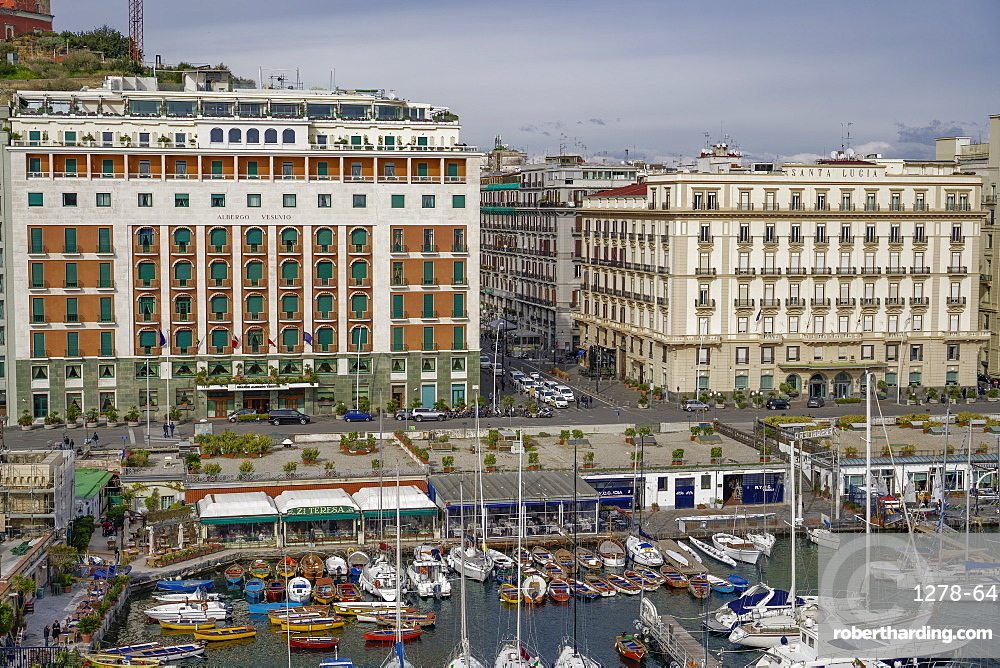 Promenade view from Ovo Castle of waterfront with hotels, and marina landscape seen from Castel dell Ovo islet fortress, Naples, Campania, Italy, Europe