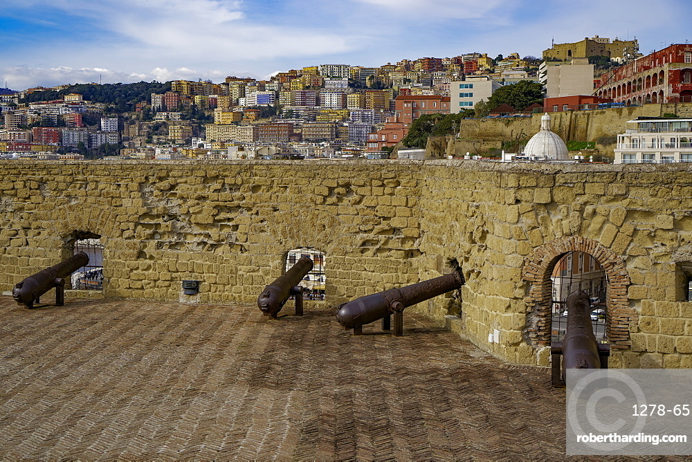 Ovo Castle fortifications with canons at Castel dell Ovo islet fortress and city view at the Gulf of Napoli, Naples, Campania, Italy, Europe