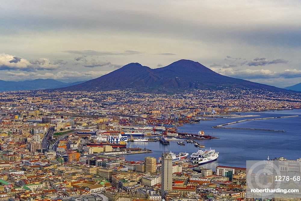 Panoramic city view over Seaport of Napoli with ships and Mount Vesuvius volcano, seen from Sant Elmo castle, Naples, Campania, Italy, Europe