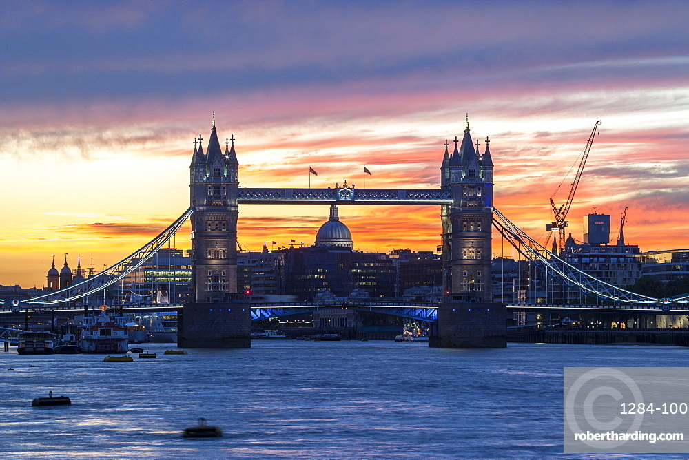 Tower Bridge, St. Paul's Cathedral and the City skyline over the River Thames at sunset, London, England, United Kingdom, Europe