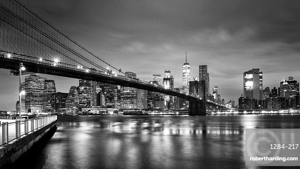 Brooklyn Bridge and Lower Manhattan skyline at dawn, New York City, New York, United States of America