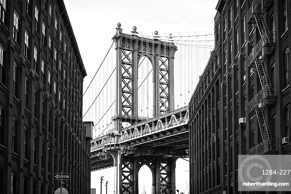 Manhattan Bridge with the Empire State Building through the Arches, New York City, New York, United States of America