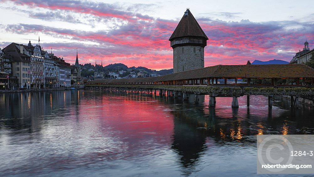 Sunrise view of the Kapellbrucke (Chapel Bridge) in Lucerne, Switzerland, Europe