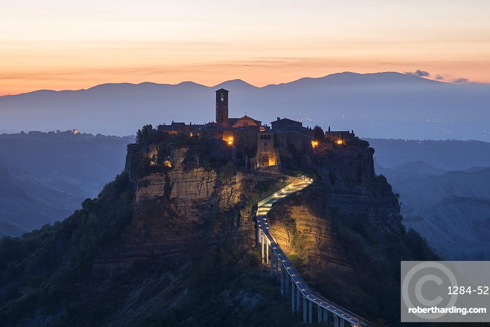 Civita di Bagnoregio, a medieval town perched on volcanic rock, just before sunrise, Lazio, Italy, Europe