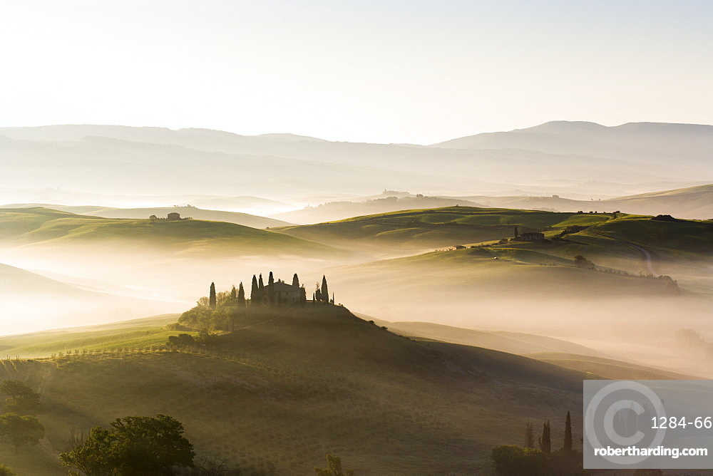 Podere Belvedere and misty hills at sunrise, Val d'Orcia, San Quirico d'Orcia, Tuscany, Italy