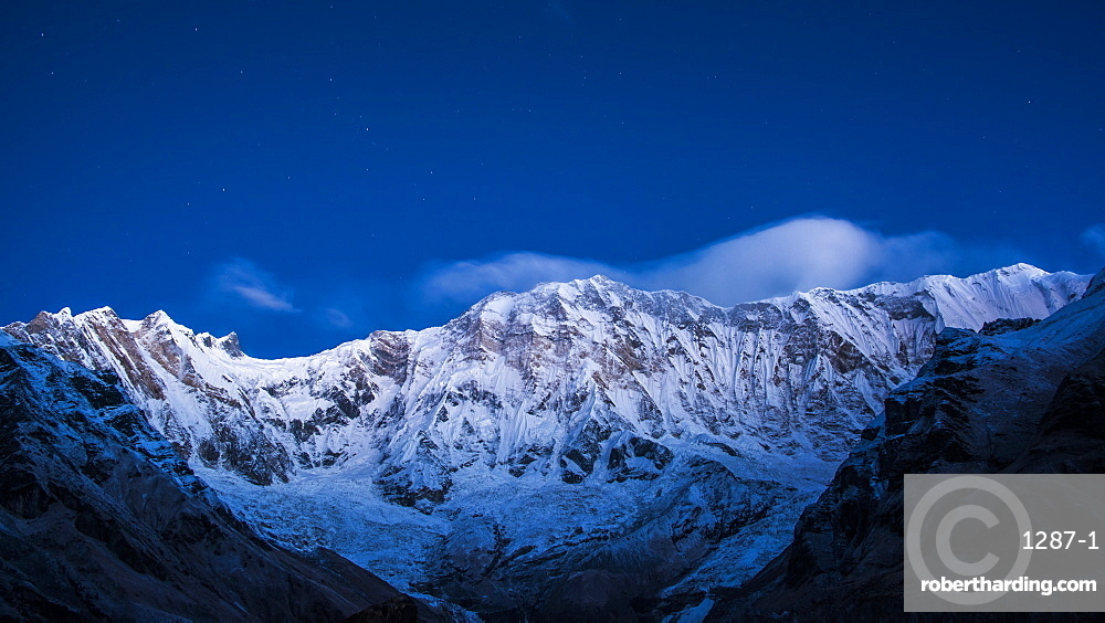 Clouds and stars at night over Annapurna, image taken from Base Camp in the Sanctuary, Himalayas, Nepal, Asia
