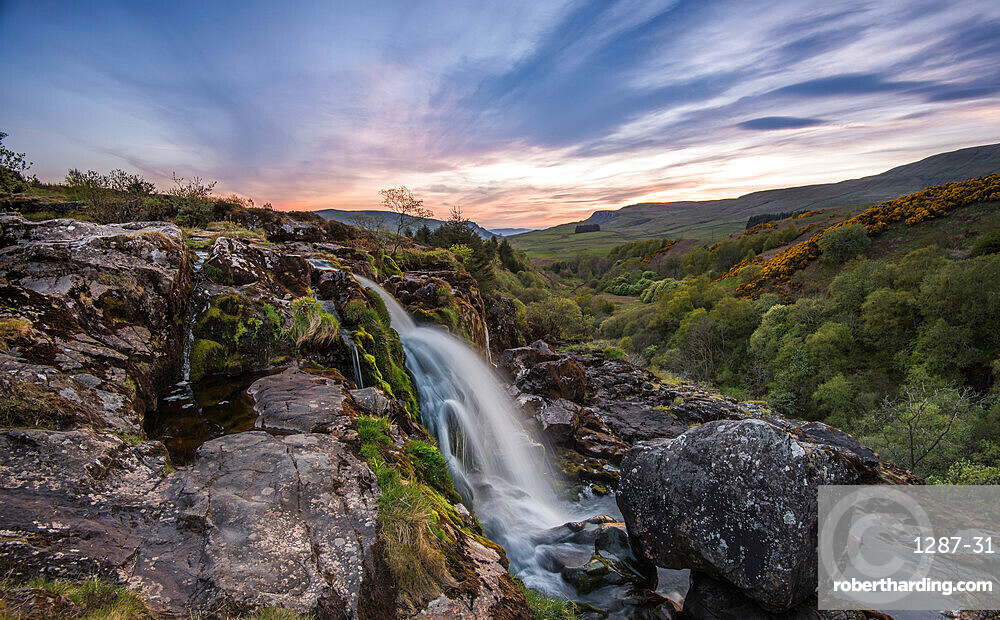 Sunset at the Loup o Fintry waterfall near the village of Fintry, Stirlingshire