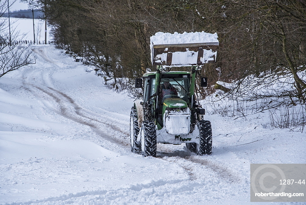 A tractor trying to clear the main road between Lennoxtown and Strathblane, East Dunbartonshire, Scotland, United Kingdom, Europe