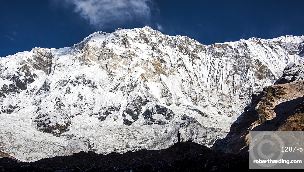 The silhouette of a photographer in front of Annapurna