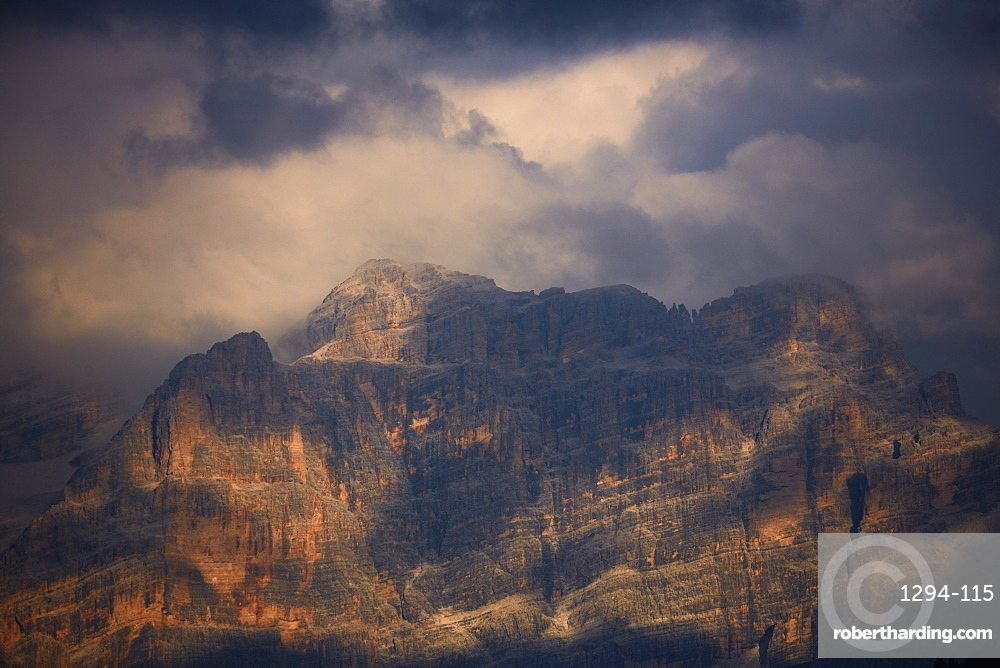 Sella mountain range in the dolomite alps seen from Groedner pass in evening light