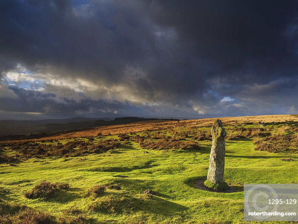 Strong light on the ancient granite Bennett's Cross, Dartmoor National Park, near Moretonhampstead, Devon UK