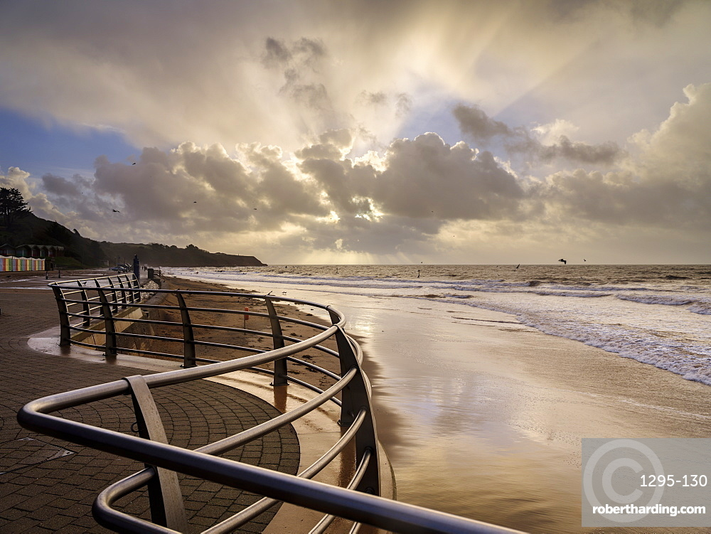Shimmering sand and railings in warm light Exmouth, Devon, UK