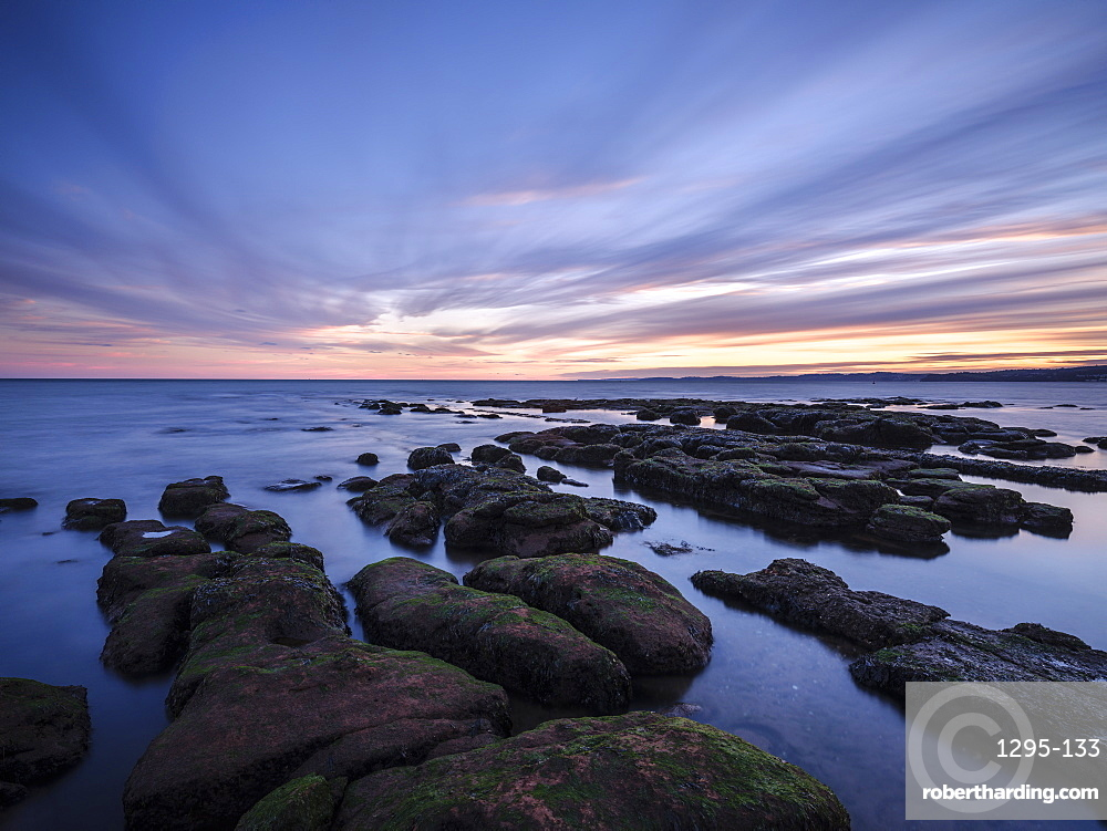 Maer Rocks in evening twilight close to the RNLI station, Exmouth, Devon, UK