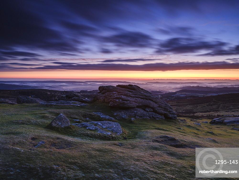 Dawn viewing East with mist in valleys, Dartmoor National Park seen from Haytor, Bovey Tracey, Devon UK